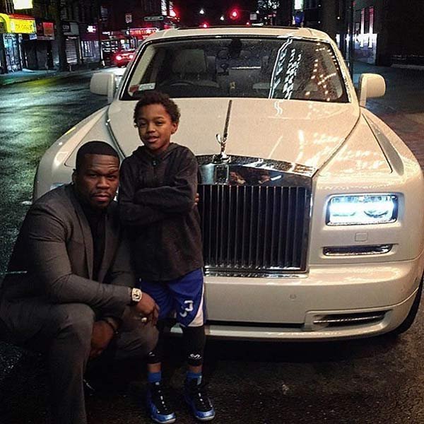 50 Cent with his car and kid
