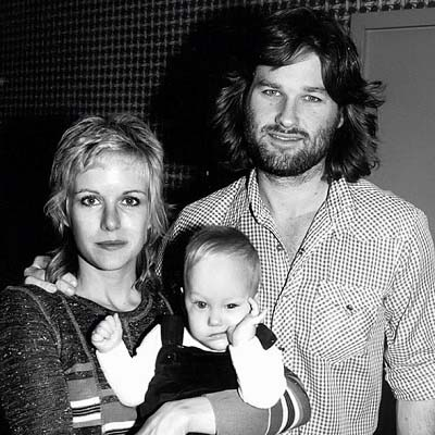 Young Boston Russell with parents Kurt Russell and Season Hubley